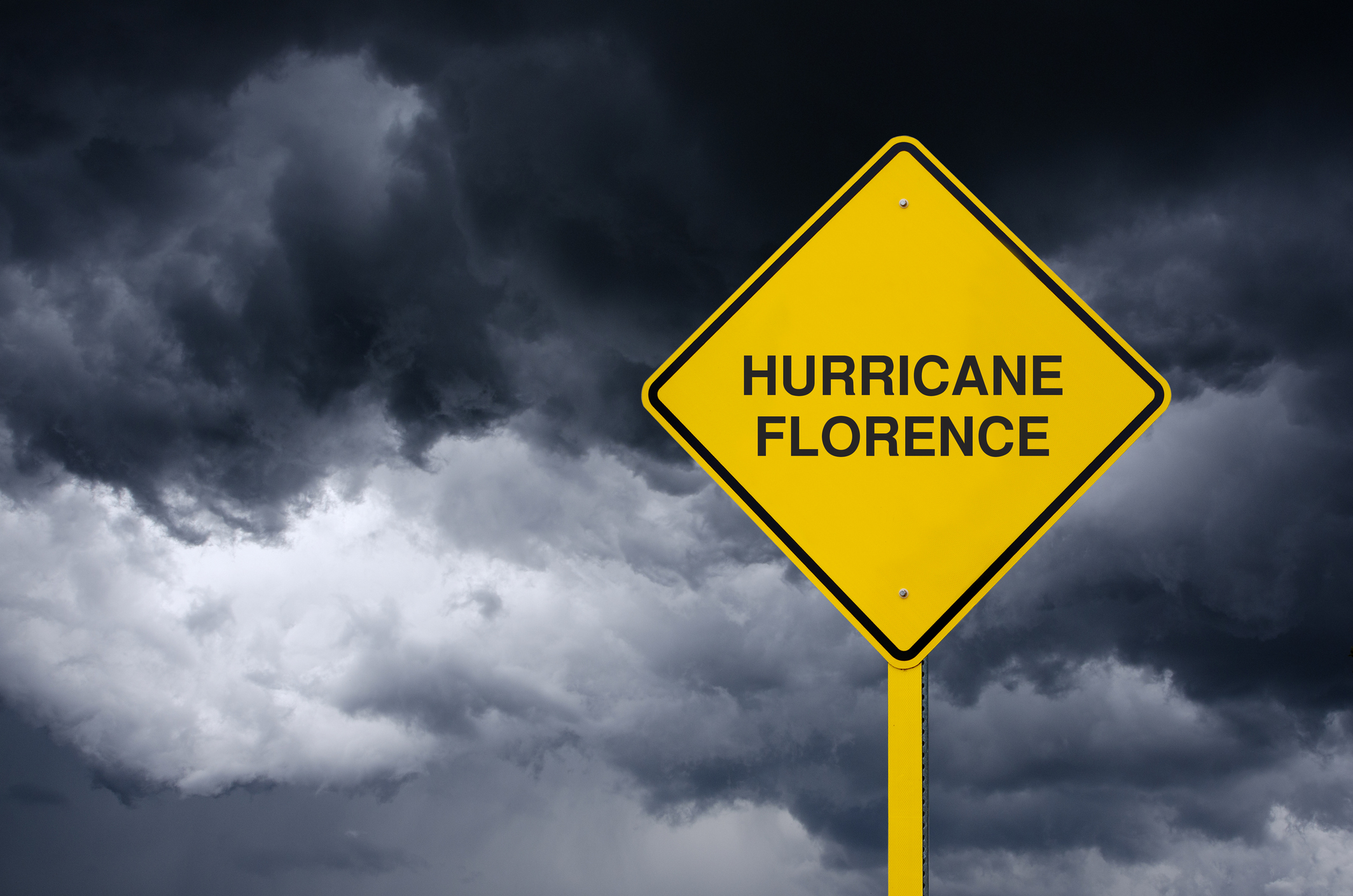 Road sign of hurricane florence in front of storm clouds 1036985136 2131x1412